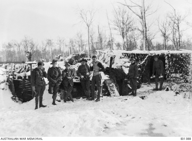 Fig.1: Gunners of the 104th Battery, Australian Field Artillery, at Ploegsteert, enjoying a hot meal after a severe snowstorm; 26 December 1917