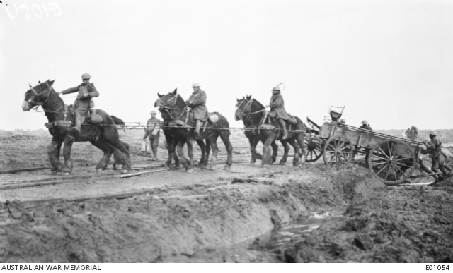Fig.2: View of slippery mud on a corduroy track in the Ypres sector which made it necessary to use six horses to pull a GS wagon from the ditch